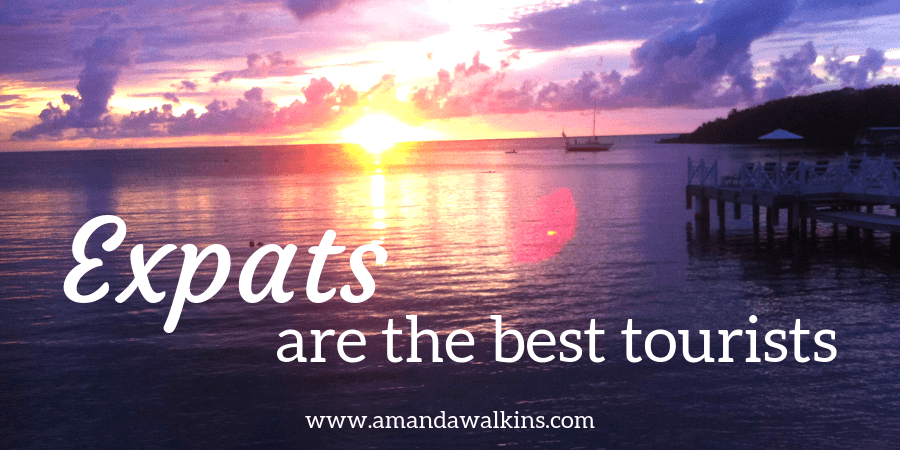 Sunset over the horizon on Roatan expats are the best tourists