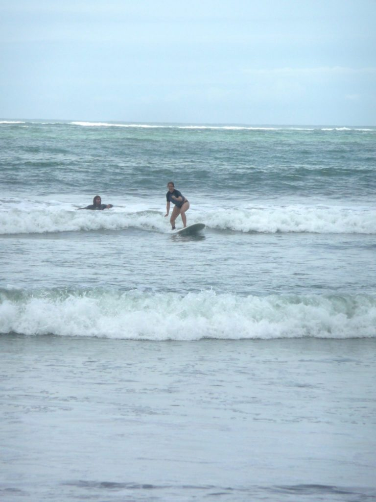 Amanda Walkins surfing a tiny little wave in Costa Rica